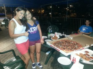 Maria and Elena are attaching the pizza